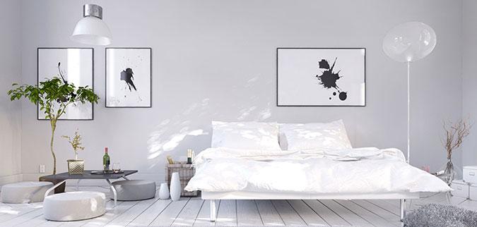 Camera da letto in stile moderno sui toni del bianco e grigio